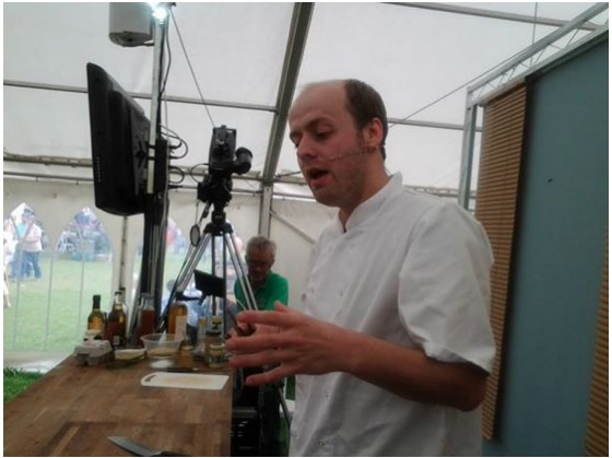 Chef Andy Link doing a demo at the Shopdon Food Festival 2014. Photo courtesy of the Riverside Inn's Facebook page.