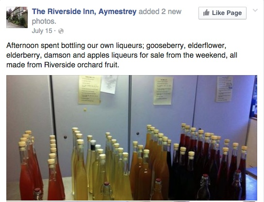 Image of bottles of fruit liqueurs made by Chef Andy Link at the Aymestrey Inn, Herefordshire