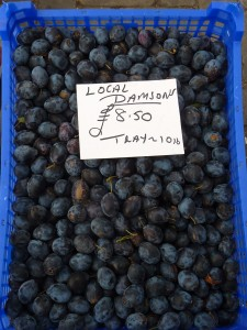 a crate of small plums known as damsons